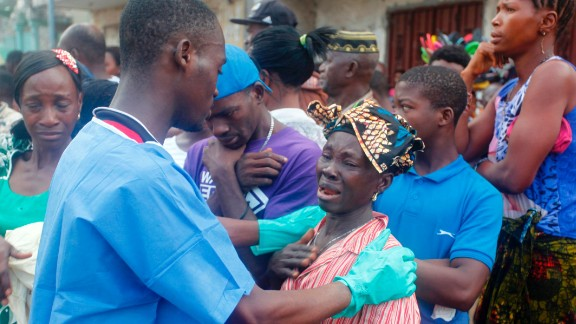 A relative of a victim of the mudslide is comforted at the Freetown morgue on Wednesday.