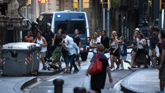 People fleeing the scene in Barcelona on Thursday after the attack.