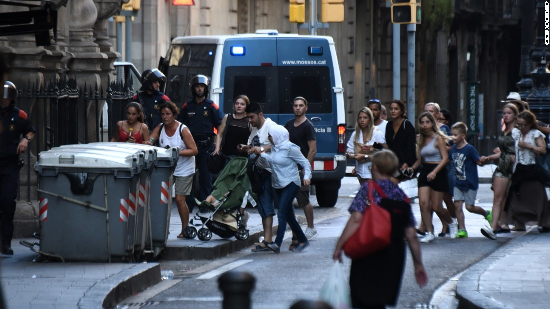 People flee the scene after the attack at Las Ramblas.