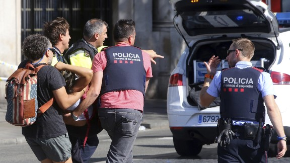 An injured person is carried by police in Barcelona.