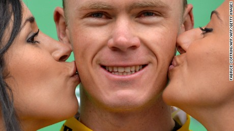 Chris Froome being kissed by two hostesses on the podium the Tour de Romandie cycling race in Belgium in 2013. But could podium girls soon become a thing of the past?