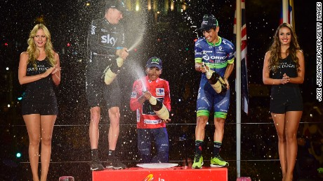 The Vuelta podium girls at work during last year's trophy ceremony with overall winner Nairo Quintana (middle), Chris Froome (left) and Esteban Chaves.