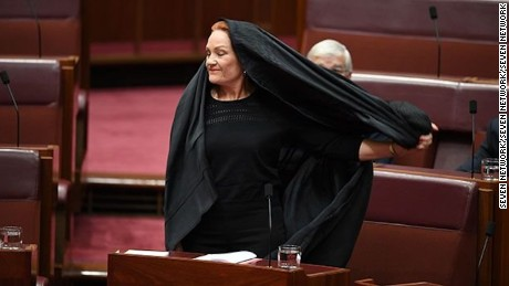 Australian Senator Pauline Hanson wears a burqa in Parliament as she calls for a burqa ban.