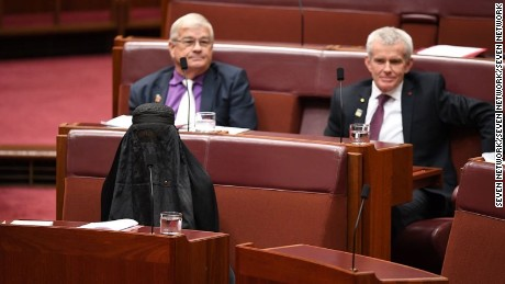 Australian Senator Pauline Hanson wears a burqa in Parliament as she calls for a burqa ban in August.