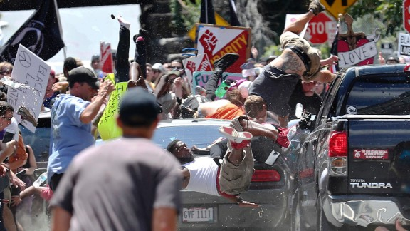 People fly into the air as a vehicle drives into a group of protesters demonstrating against a white nationalist rally in Charlottesville, Va., Saturday, Aug. 12, 2017. The nationalists were holding the rally to protest plans by the city of Charlottesville to remove a statue of Confederate Gen. Robert E. Lee. There were several hundred protesters marching in a long line when the car drove into a group of them. (Ryan M. Kelly/The Daily Progress via AP)