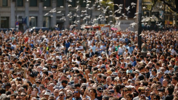 Pigeons fly over a Barcelona crowd that gathered for a minute of silence on August 18.