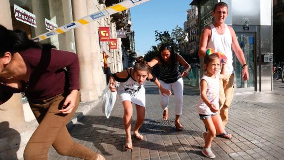 People evacuate an area of Barcelona on August 17.