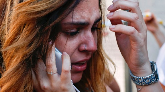 A woman cries as she speaks on her phone in Barcelona on August 17.
