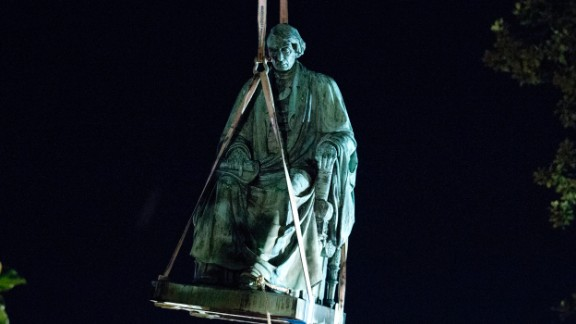 A monument of Chief Justice Roger B. Taney is removed early Friday at the Maryland State House.