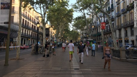 Las Ramblas is one of the most popular areas of Barcelona for tourists, who pack its pavement cafes and shop at its market.