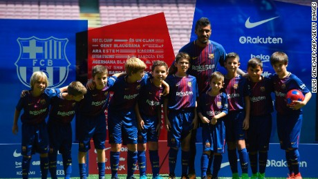 Barcelona's new Brazilian football player Paulinho Bezerra poses with young Barcelona's fans during his official presentation, after signing his new contract with the Catalan club at the Camp Nou stadium in Barcelona on August 17, 2017. / AFP PHOTO / LLUIS GENE        (Photo credit should read LLUIS GENE/AFP/Getty Images)