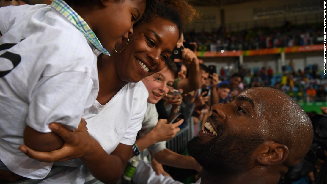 Riner celebrates his gold medal with girlfriend Luthna Plocus and son Eden -- whose birth he describes as the greatest moment of his life.