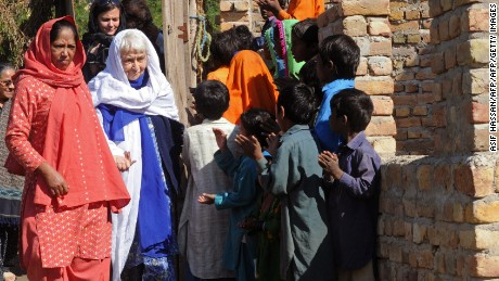 Ruth Pfau is welcomed by brick kiln laborers in Karachi in 2010.