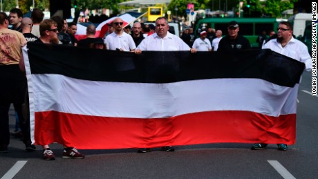 Extreme right-wings demonstrators gather prior to a neo-Nazi rally on the occasion of the 30th anniversary of the death of Hitler's deputy Rudolf Hess in Berlin Spandau on August 19, 2017. Hess was sentenced for war crimes and served his sentence in the Criminal Prison in Berlin Spandau, until he commited suicide in 1987.