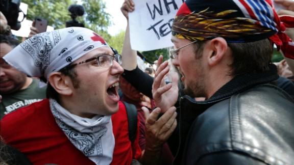 A counterprotester, left, confronts a professed Trump supporter Saturday on Boston Common.