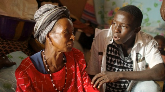 Hawa Marah and her grandson. She lost three of her five children, and her home in the disaster and doesn't know where she and her family will live going forward.