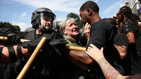 Protesters face off with riot police escorting conservative activists following a march in Boston against a planned 'Free Speech Rally' just one week after the violent 'Unite the Right' rally in Virginia left one woman dead and dozens more injured on August 19, 2017 in Boston, United States. Although the rally organizers stress that they are not associated with any alt-right or white supremacist groups, the city of Boston and Police Commissioner William Evans are preparing for possible confrontations at the afternoon rally.