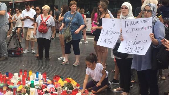 Muslim women denounce terrorism at a memorial Saturday on Las Ramblas in Barcelona.