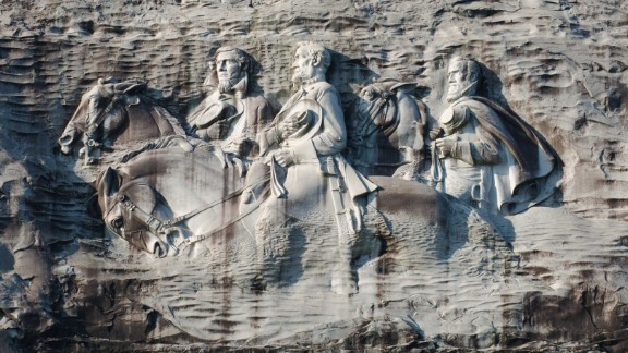 """The Confederate carving on Stone Mountain depicts Jefferson Davis, Robert E. Lee and Thomas J. """"Stonewall"""" Jackson."""