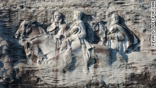 at stone mountain hikers try to rise above its racial history cnn