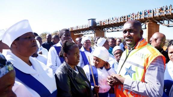 Local officials address community members after deadly minibus crash near Pietermaritzburg, South Africa.