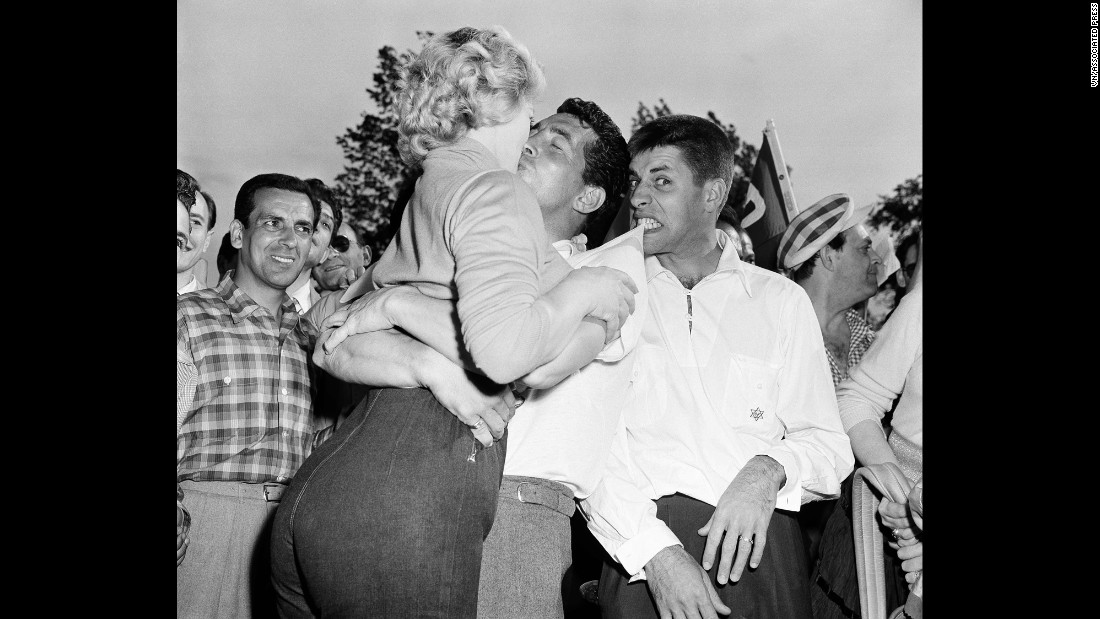 Martin, center, kisses actress Denise Darcel, as Lewis feigns irritation. The pair were at a golf event in 1953 in Eastchester, New York.