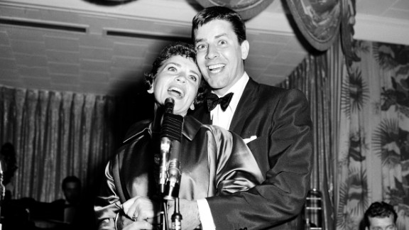 Lewis and his wife, Patti, sing in an impromptu New York performance in 1955. They divorced in 1982.