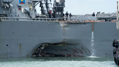 'Some remains' of missing 10 sailors found after collision, admiral says
