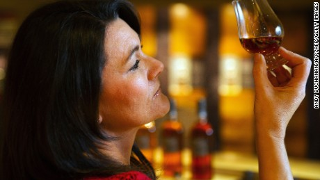 Visitor centre manager Wendy Dunlop samples the produce at the Auchentoshan Distillery, a Single Malt whisky distillery, on the outskirts of Glasgow on December 12, 2016.  While most of Scotland voted against leaving the European Union, whisky makers have quietly been raising a wee dram to a side-effect of the Brexit vote -- a plunge in the value of the pound. The currency devaluation has made exports cheaper, generating a bump since 90 percent of Scotch whisky is sold outside Britain, although the industry warns the longer-term outlook is far more cloudy.   / AFP / ANDY BUCHANAN / TO GO WITH AFP STORY BY MARK MCLAUGHLIN        (Photo credit should read ANDY BUCHANAN/AFP/Getty Images)