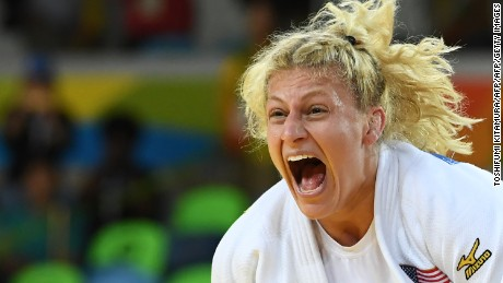 US Kayla Harrison celebrates after defeating France's Audrey Tcheumeo during their women's -78kg judo contest gold medal match of the Rio 2016 Olympic Games in Rio de Janeiro on August 11, 2016. / AFP / Toshifumi KITAMURA        (Photo credit should read TOSHIFUMI KITAMURA/AFP/Getty Images)