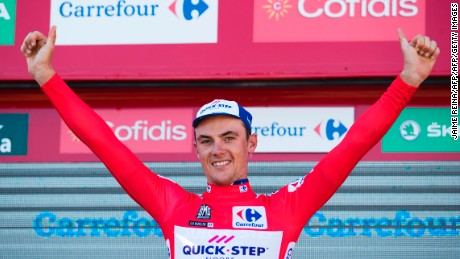 Belgium cyclist Yves Lampaert celebrates on the podium after winning La Vuelta's second stage.