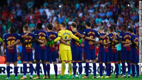 BARCELONA, SPAIN - AUGUST 20: FC Barcelona players line up to observe a minute's silence in memory of victims of the terrorist attack in Barcelona this week prior to start the La Liga match between FC Barcelona and Real Betis Balompie at Camp Nou stadium on August 20, 2017 in Barcelona, Spain. (Photo by Gonzalo Arroyo Moreno/Getty Images)
