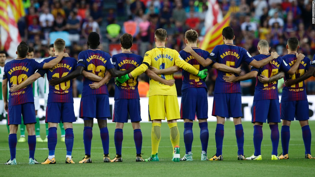 "Barcelona players -- wearing their city on their jerseys instead of their names -- observe a minute of silence before a Spanish league match against Real Betis on Sunday, August 20. Three days earlier, <a href=""http://www.cnn.com/2017/08/17/europe/gallery/barcelona-van-attack/index.html"" target=""_blank"">a van rammed into a crowd of people</a> in Barcelona, killing 13 and injuring more than 100."