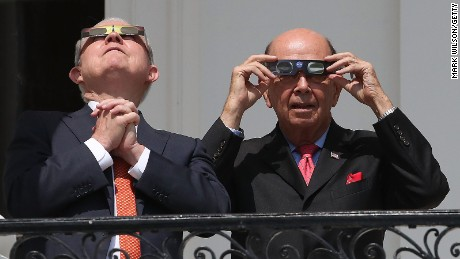 Attorney General Jeff Sessions (left) and Commerce Secretary Wilbur Ross wear special glasses to view the solar eclipse at the White House on August 21, 2017.