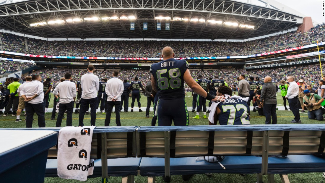 "Seattle center Justin Britt puts his hand on Michael Bennett's shoulder as Bennett protests during the national anthem on Friday, August 18. Bennett recently <a href=""http://www.espn.com/nfl/story/_/id/20363083/michael-bennett-seattle-seahawks-says-involvement-white-players-help-anthem-protests"" target=""_blank"">told ESPN</a> that he thought white players getting involved in anthem protests ""would change the whole conversation"" regarding racism and social inequality, and Britt was one of several white players <a href=""http://www.latimes.com/sports/nfl/la-sp-nfl-preseason-anthem-20170821-story.htmlhttp://bleacherreport.com/articles/2728333-justin-britt-stands-next-to-michael-bennett-during-national-anthem-protest"" target=""_blank"">who showed solidarity</a> with their black teammates during anthems this past week. <a href=""http://www.cnn.com/2017/08/16/sport/seahawks-michael-bennett-not-standing-for-national-anthem/index.html"" target=""_blank"">Read more: Bennett tells CNN why he can't stand for the anthem</a>"