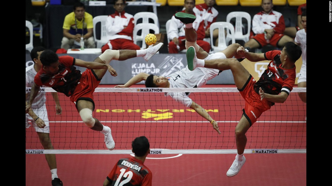 Thailand's Pornchai Kaokaew, center, kicks a ball during a sepak takraw match against Indonesia on Friday, August 18.
