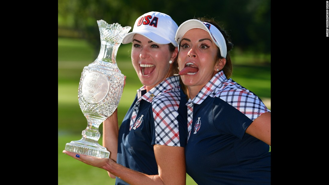 Paula Creamer, left, and Gerina Piller pose with the Solheim Cup trophy after Team USA defeated Europe on Sunday, August 20.