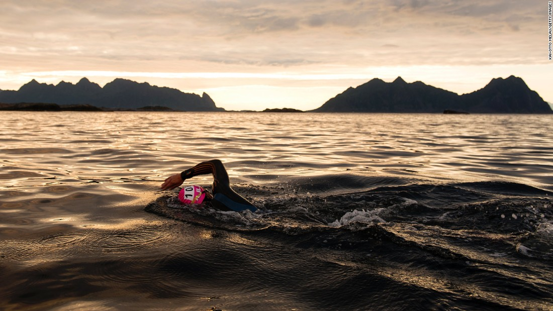 "A triathlete swims in Svolvar, Norway, during an Arctic Triple event on Saturday, August 19. The Lofoten Triathlon Extreme started with a swim of about 2.5 miles, and it was followed by a bike ride of nearly 122 miles and a run of 28 miles. <a href=""http://www.cnn.com/2017/08/15/world/gallery/what-a-shot-sports-0815/index.html"" target=""_blank"">See 28 amazing sports photos from last week</a>"
