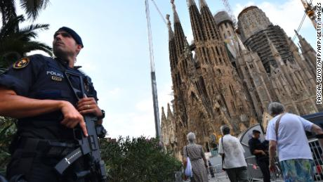"TOPSHOT - A police officer stands by the Sagrada Familia basilica in Barcelona on August 20, 2017, before a mass to commemorate victims of two devastating terror attacks in Barcelona and Cambrils. A grief-stricken Barcelona prepared today to commemorate victims of two devastating terror attacks at a mass in the city's Sagrada Familia church. As investigators scrambled to piece together the attacks which killed 14 people in all, Interior Minister Juan Ignacio Zoido said on August 19 the cell behind the carnage that also injured 120 and plunged the country into shock had been ""dismantled,"" though local authorities took a more cautious tone.   / AFP PHOTO / PASCAL GUYOT        (Photo credit should read PASCAL GUYOT/AFP/Getty Images)"