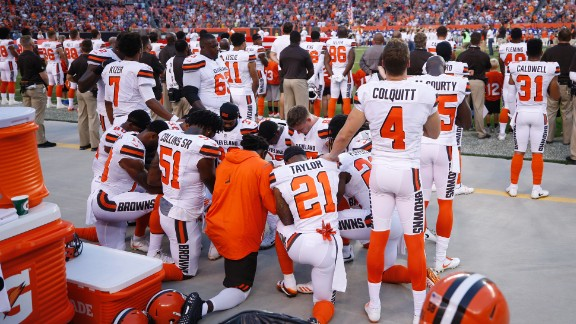 A group of Cleveland Browns players kneel in a circle in protest during the national anthem prior to a preseason game against the New York Giants on August 21, 2017 in Cleveland, Ohio.
