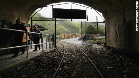 LYNCH, KY - APRIL 18:  Workers enter the former entrance to the Portal 31 coal mine, now a tourist attraction, on April 18, 2012 in Lynch, Kentucky. The historic coal mining town of Lynch once boasted a population of more than 10,000 and at one time was the largest coal camp in the world. Following the increased mechanization of the coal mining process, the town's population has dwindled to less than 1,000. Two proposed strip mines in the area now potentially threaten the town's water supply.  (Photo by Mario Tama/Getty Images)