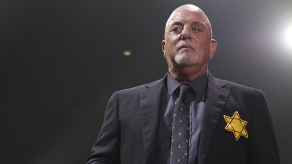 Billy Joel wears a jacket with the Star of David during the encore of his 43rd sold out show at Madison Square Garden on August 21, 2017 in New York City.