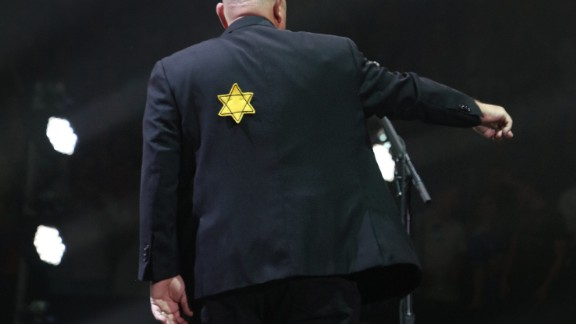 Billy Joel wears a jacket with the Star of David during the encore of his 43rd sold out show at Madison Square Garden on August 21, 2017.