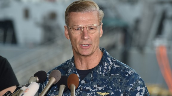 Vice Adm. Joseph Aucoin, Commander of the US 7th Fleet, delivers a speech during a press conference in front of the guided missile destroyer USS Fitzgerald at US Navy Yokosuka Base, southwest of Tokyo on June 18, 2017. A number of missing American sailors have been found dead in flooded areas of a destroyer that collided with a container ship off Japan's coast, the US Navy said on June 18, 2017. / AFP PHOTO / Kazuhiro NOGI        (Photo credit should read KAZUHIRO NOGI/AFP/Getty Images)