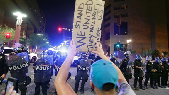 Protesters yell after Phoenix police used tear gas outside the convention center Tuesday night.