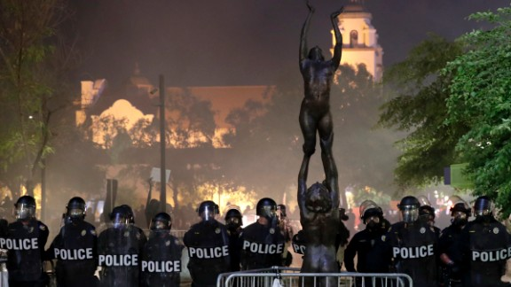 Phoenix police move protesters away after using tear gas outside the Phoenix Convention Center, Tuesday, Aug. 22, 2017, in Phoenix. Protests were held against President Donald Trump as he hosted a rally inside the convention center. (AP Photo/Matt York)