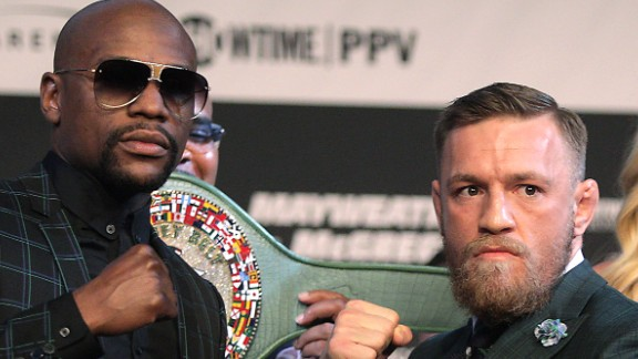 Boxer Floyd Mayweather Jr. (L) and MMA figher Connor Mcgregor pose during a media press conference August 23, 2017 at the MGM Grand in Las Vegas, Nevada.  Mayweather, the 40-year-old undefeated former welterweight boxing champion, has been lured out of retirement to face McGregor, a star of mixed martial arts' Ultimate Fighting Championship. The two men meet in a 12-round contest under boxing rules on August 26th that is tipped to become the richest fight in history.  / AFP PHOTO / John Gurzinski        (Photo credit should read JOHN GURZINSKI/AFP/Getty Images)