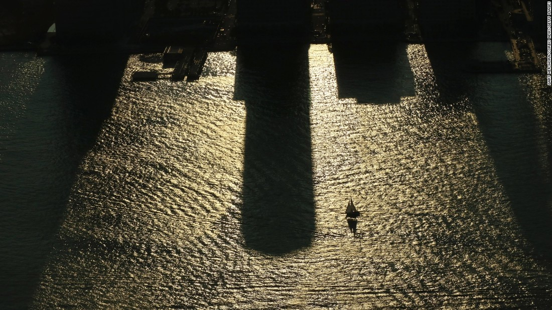 <strong>New York:</strong> <strong> </strong>A sailboat glides across the shadows of buildings in the Hudson River at sunset on August 20, 2017 as the US prepares to witness a solar eclipse. The eclipse was witnessed across the country along apath from Oregon to South Carolina.