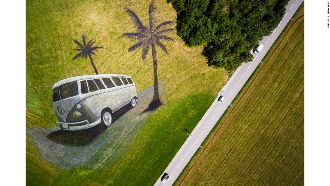 <strong>Chateau d'Oex, Switzerland:</strong> A land art painting on a hill by French artist portrays a classic Volkswagen camper van. The artwork covers 4,200 square meters and was produced with over 400 liters of biodegradable paint to celebrate an international VW festival.