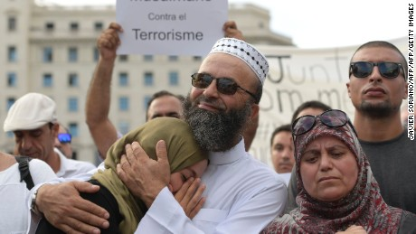 Members of the muslim community demonstrate at Plaza de Catalunya in Barcelona on August 21, 2017 to protest against terrorism four days after the Barcelona and Cambrils attacks that killed 15 people. Spanish police said on August 21, 2017 that they have identified the driver of the van that mowed down pedestrians on the busy Las Ramblas boulevard in Barcelona. The 22-year-old Moroccan Younes Abouyaaqoub is believed to be the last remaining member of a 12-man cell still at large in Spain or abroad, with the others killed by police or detained over last week's twin attacks in Barcelona and the seaside resort of Cambrils that claimed 14 lives, including a seven-year-old boy. / AFP PHOTO / JAVIER SORIANO        (Photo credit should read JAVIER SORIANO/AFP/Getty Images)